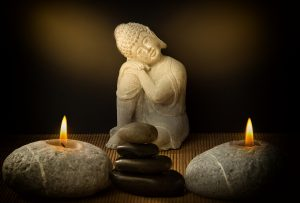 buddha with candles